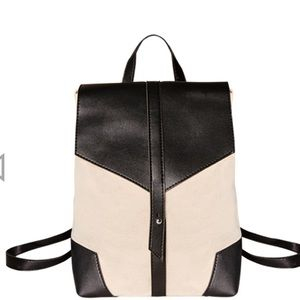 Canvas backpack with black leather